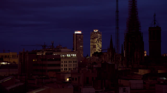 W/S Barcelona, gothic cathedral skyline at dusk-night, towers Mapfre and Hotel Arts