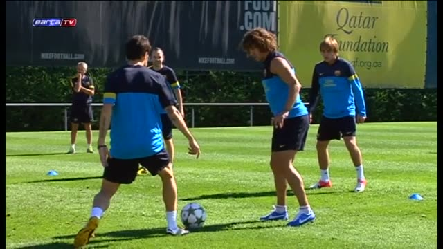 Barcelona Oct 1 Barça's Carles Puyol and Adriano Correia and Andres Iniesta with medical discharge in hand worked out with the rest of their...