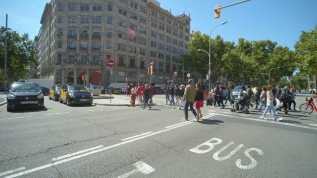 Barcelona Passeig Paseo de Gracia boulevard dolly shot. Gran Via de les Corts Catalanes crossroad