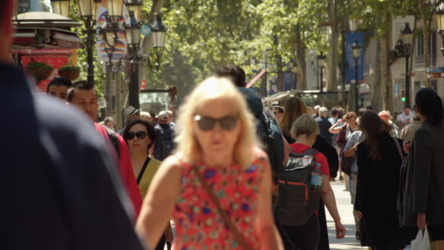 barcelona ramblas crowded in slow motion. famous street establishing shot filmed slow motion with telephoto lens with defocused crowd - terrorism stock videos & royalty-free footage