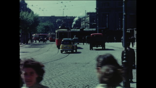 Barcelona street scene with people cars and trams Spain circa August 1958