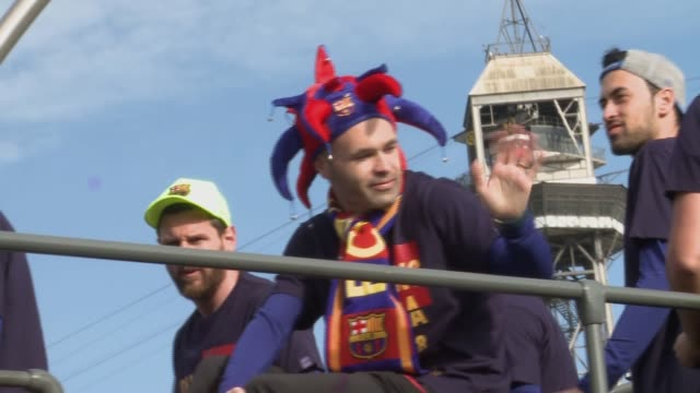 Barcelona supporters welcome players during the FC Barcelona Victory Parade in celebration of the La Liga and Copa Del Rey titles