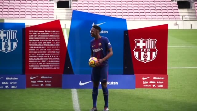 Barcelona's latest recruit Colombian defender Yerry Mina takes his first steps in the team's stadium Camp Nou after signing from Brazilian side...