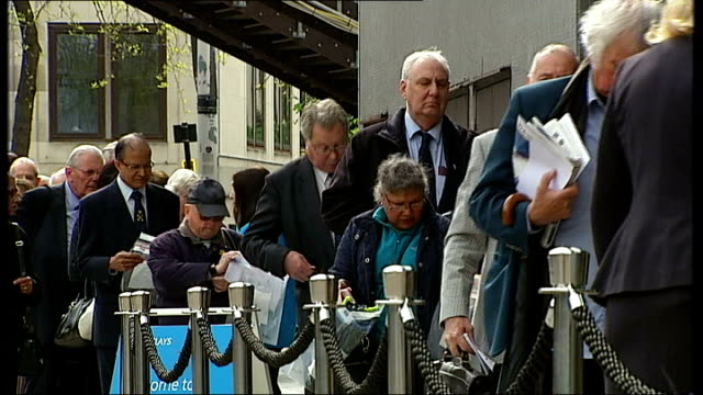 barclays bank announces job losses; 24.4.2014 / t24041426 london: southbank: ext various of people queuing to enter barclays annual general meeting... - annual general meeting stock videos & royalty-free footage