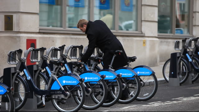 barclays cycle hire scheme, or borris bikes, part of a green initiative by transport for london. - energy efficient stock videos & royalty-free footage