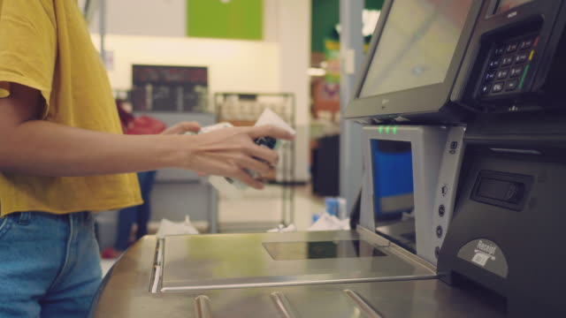barcode scanner at shopping cash register - checkout stock videos and b-roll footage