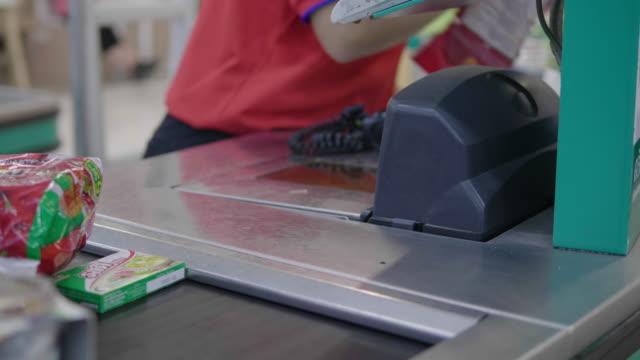 barcode scanner for cash registers - supermarket - cashier stock videos & royalty-free footage