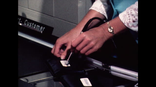 barcodes being read at first electronic checkout; 1971 - checkout stock videos & royalty-free footage