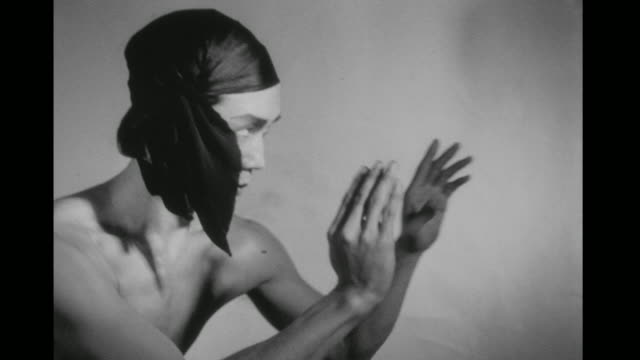 1948 bare chested man (chao-li chi) performs shadow boxing moves in slow motion in an empty room - asiatischer kampfsport stock-videos und b-roll-filmmaterial