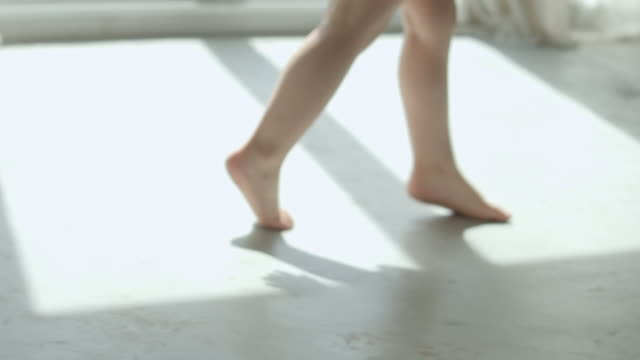 bare feet of a baby girl walking,slow motion - shadow stock videos & royalty-free footage