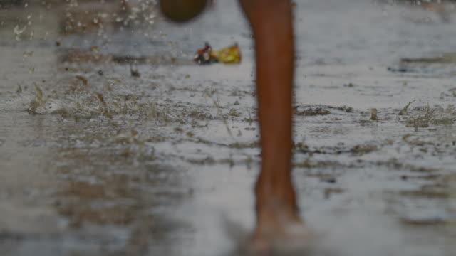 bare feet running on sodden path / kannauj, uttar pradesh, india - barefoot stock videos & royalty-free footage