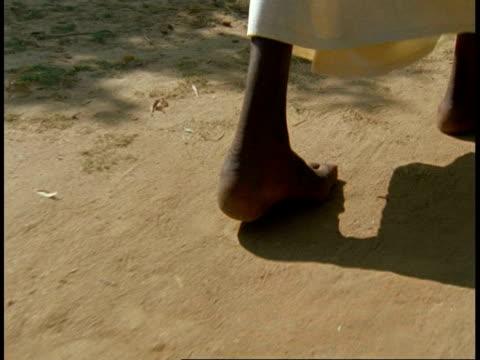 cu bare feet walking over sandy ground, bandhavgarh national park, india - barefoot stock videos & royalty-free footage