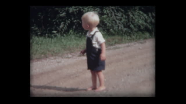1967 barefoot boy and grandparents on country road - polaroid video stock e b–roll