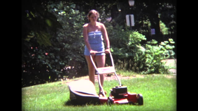 1975 barefoot girl with lawn mower - lawn mower stock videos and b-roll footage