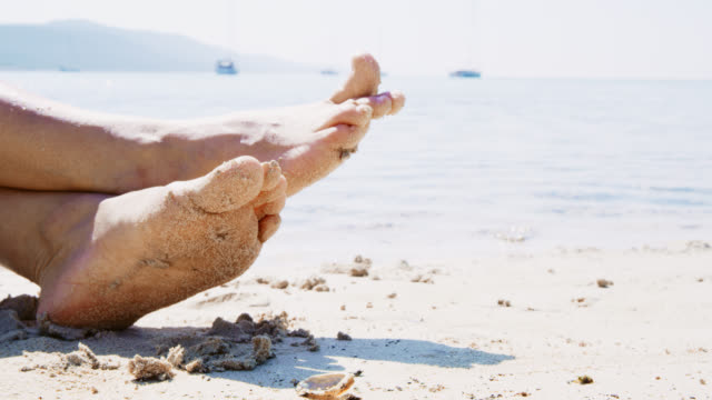 cu barefoot in sand - sunbathing stock videos and b-roll footage