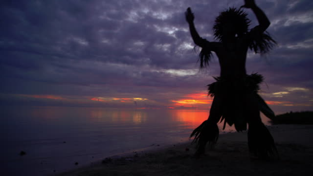 barefoot polynesian male warrior dancer entertaining at sunset - tahitian culture stock videos & royalty-free footage