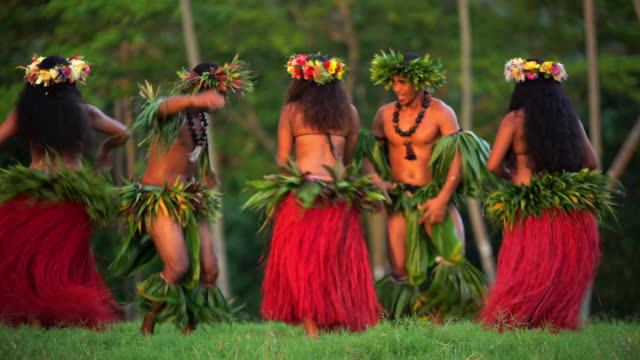 Barefoot Tahitian males in warrior dress traditional dance