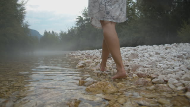 slo mo barefoot woman walking in the stream - barefoot stock videos & royalty-free footage