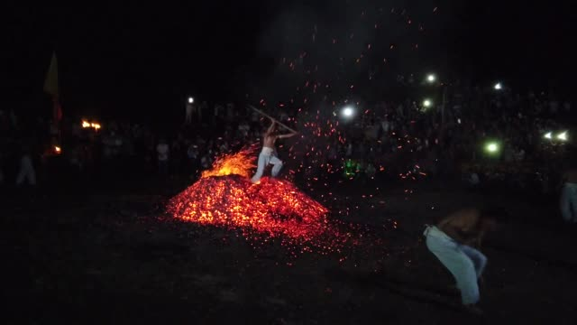 a barefooted man walks through burning charcoal as he performs 'lianhuo' or 'fire walking' to celebrate the double ninth festival on october 7 2019... - zhejiang province stock videos & royalty-free footage