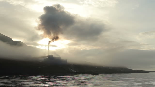 Barentsburg - Scenic view from the sea on the pipe and smoke