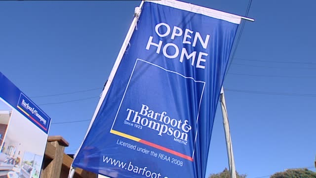 barfoot thompson real estate sign and flag outside property for sale advertising open home in progress - real estate sign stock videos & royalty-free footage