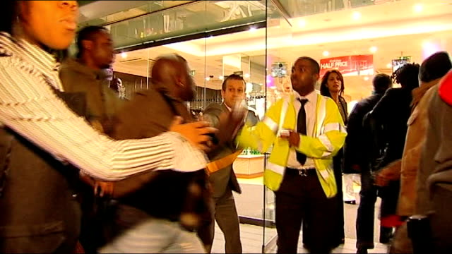 bargain hunters hit the sales on boxing day england london oxford street frenzied scenes outside next clothes store as shoppers push to enter the... - sale stock videos and b-roll footage