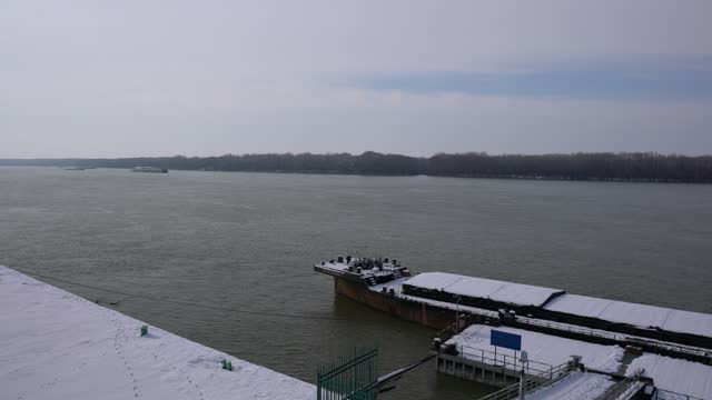 a barge anchored on danube river bank in winter time - pavel gospodinov stock videos & royalty-free footage