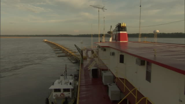 a barge dredges the mississippi river. - barge stock videos & royalty-free footage