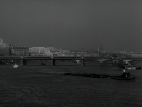 a barge moves past the festival of britain building site on the south bank of the thames - festival of britain stock videos & royalty-free footage