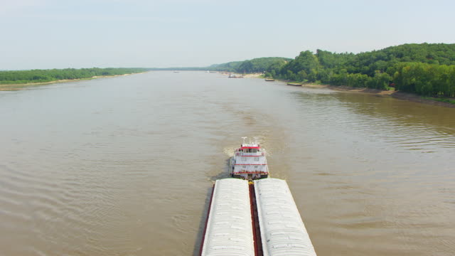 WS AERIAL POV Barge moving in Mississippi River, forest in background / East St. Louis, St. Clair County, Illinois, United States