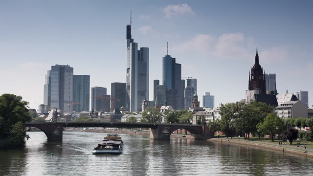 WS Barge on River Main with Commerzbank Tower and skyscrapers in background / Frankfurt, Hessen, Germany