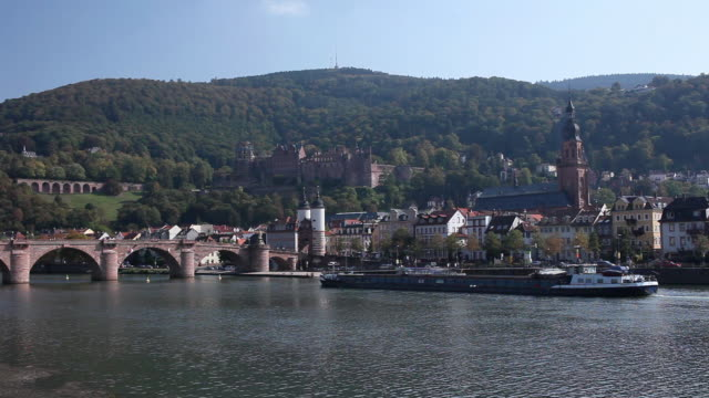 ws barge on river neckar with heidelberg castle and church of the holy spirit in background / heidelberg, baden-wuerttemberg, germany - heidelberg castle stock videos & royalty-free footage