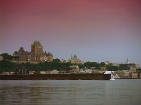 Barge on St Lawrence River with Chateau Frontenac on hill in background