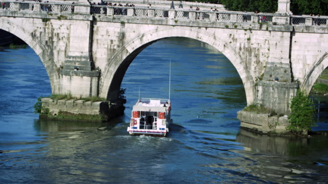 barge passes under arch of ponte sant'angelo - arch bridge stock videos & royalty-free footage