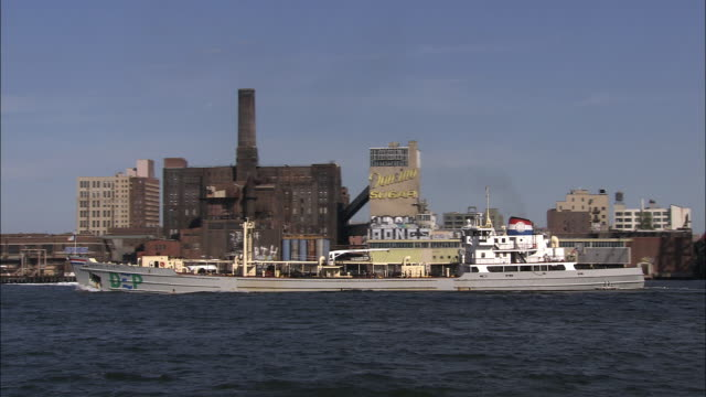 a barge passes under the williamsburg bridge - barge stock videos & royalty-free footage