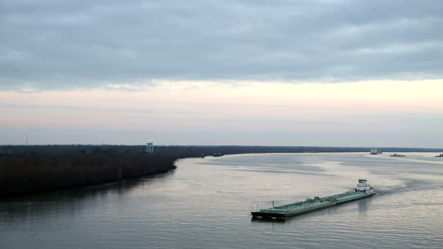 Barge sailing down the Mississippi river