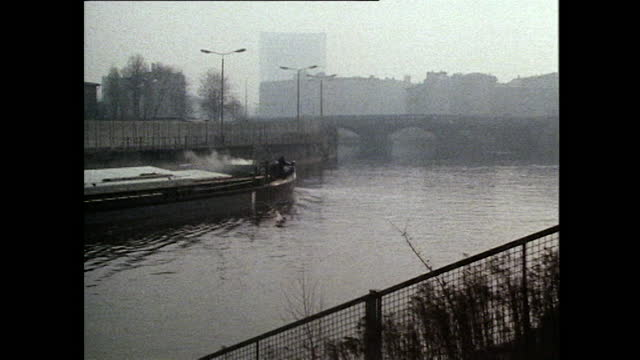 barge travels along a canal in misty berlin' 1985 - 1985 stock videos & royalty-free footage