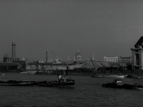 barges move past the festival of britain building site on the south bank of the thames - festival of britain stock videos & royalty-free footage