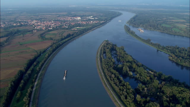 barges on the rhine near gerstheim  - aerial view - alsace, bas-rhin, arrondissement de sélestat-erstein, france - barge stock videos & royalty-free footage