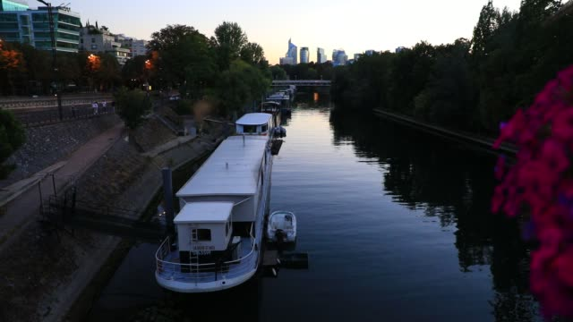 barges on the seine river in the background the skyscrapers of the la defense business district on july 29 2020 in levallois perret france the town... - generic location stock videos & royalty-free footage