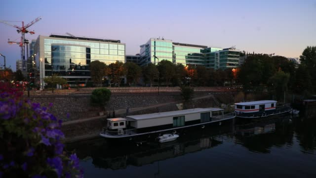 barges on the seine river office buildings in the background on july 29 2020 in levallois perret france the town of levallois perret is one of the... - generic location stock videos & royalty-free footage
