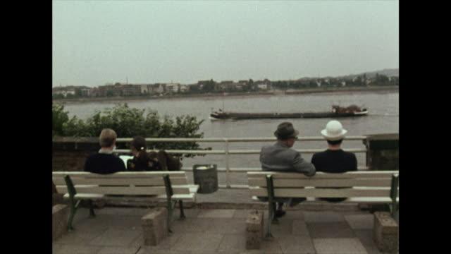 barges travel down the rhine river; 1972 - north rhine westphalia stock videos & royalty-free footage