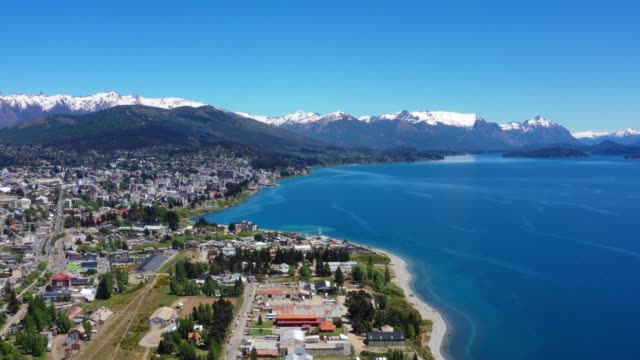 bariloche city by lake panorama. andes in background. argentina - argentina stock videos & royalty-free footage