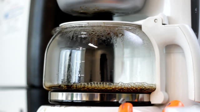 barista brews coffee in coffee maker close up - coffee cup stock videos & royalty-free footage