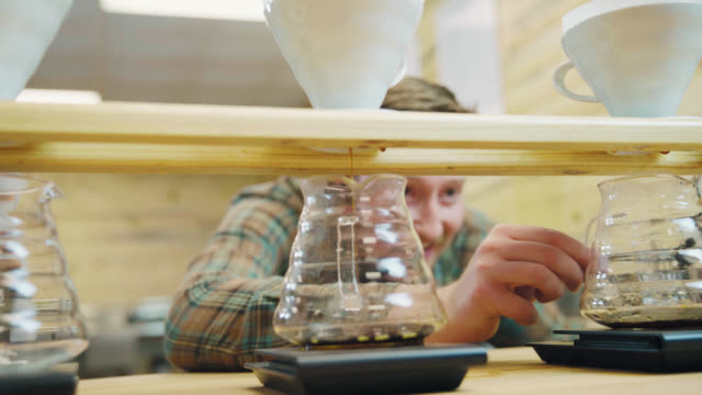barista checks on drip coffee - seattle coffee stock videos and b-roll footage