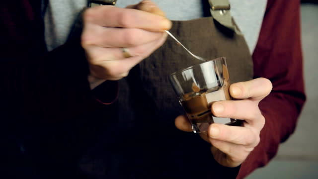 barista greasing a glass with chocolate - mocha stock videos and b-roll footage