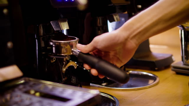 barista grinding coffee beans with coffee machine and and making a shot of espresso coffee - grinding stock videos & royalty-free footage
