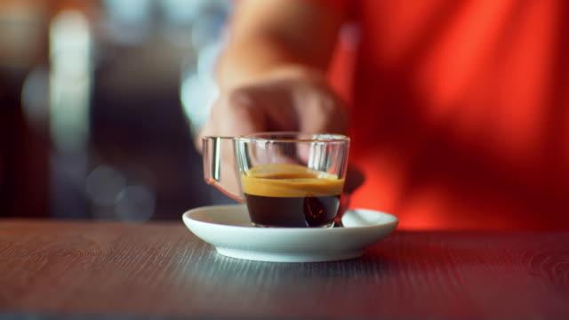 Barista In Coffee Shop Serving shot Of Espresso