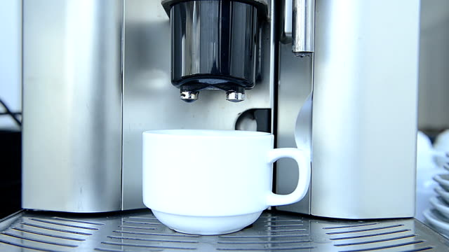 barista makes coffee in the coffee machine - cafe macchiato stock videos and b-roll footage