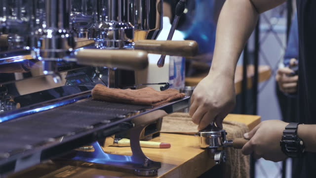 barista makes coffee, interior bar - espresso maker stock videos and b-roll footage